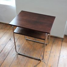 Functionalist table with storage space