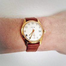 Prim wristwatch with gilded case