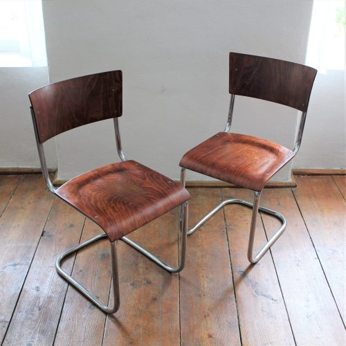 pair of tubular chairs
